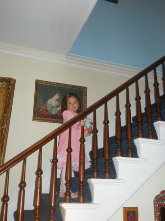 Montour Falls, NY: A formal pose on the staircase of Cook Mansion