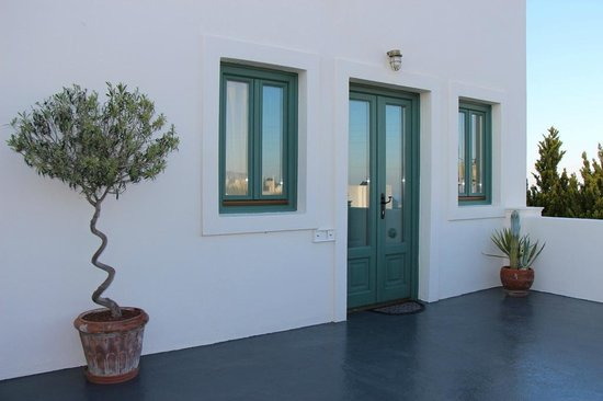 Anastasis Apartments: outside of the white suite entry
