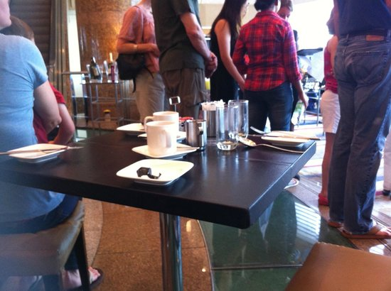 Hilton Kuala Lumpur: Tired mother and child decided to sit down at empty table as queue lengthened