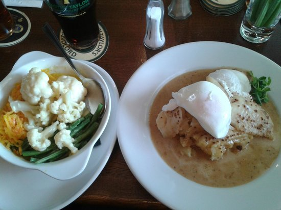 Bradford, UK: Plaice on a bed of mash potato, with poached egg, and a mustard sauce dressing, very nice