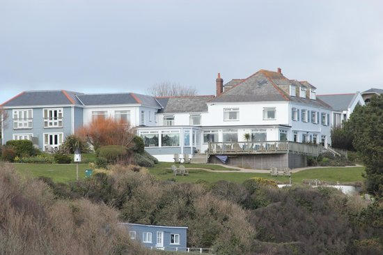 Driftwood Hotel stands on the top of the cliff right by the coastal path