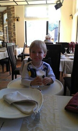 Bran, Romania: my kid taking lunch at hotel's reataurant