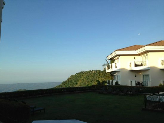 The Lake Hotel Tagaytay: view outside our room at 6-7am.  Moon is still up on the right side. (photo & caption by my hubb