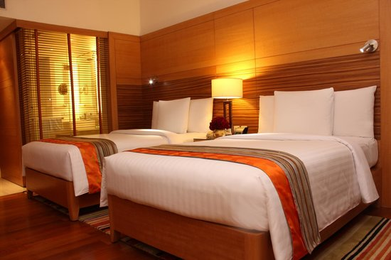 Courtyard by Marriott Gurgaon: Our deluxe twin rooms provide ample of space for two guests.
