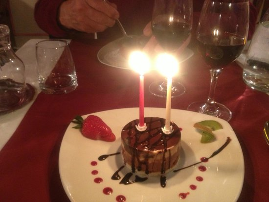Richelieu, Frankreich: triple chocolate dessert  with birthday candles