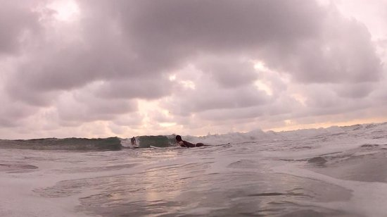 Nosara, Costa Rica: Catching an unbroken wave at the beginning of the rainy season (rare overcast day)