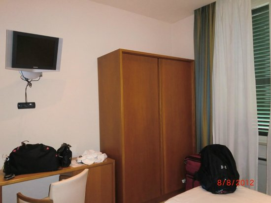 Crosti Hotel: The closet, desk, &amp; flat screen in our room.