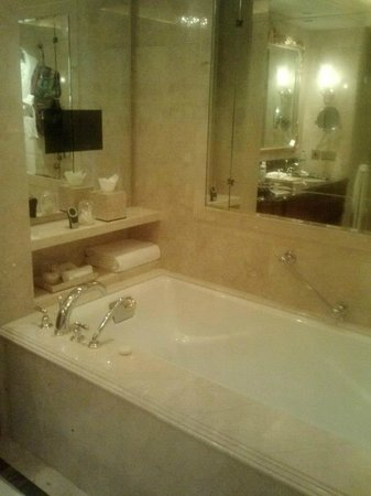 The Leela Palace New Delhi: soaker tub w/ tv.