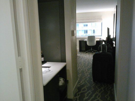 Hotel InterContinental Miami: view from front door/bathroom door - mini bar