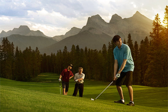 Canadian Rockies, Canada: Men Golfing at Silvertip Golf Resort, Canmore, Alberta