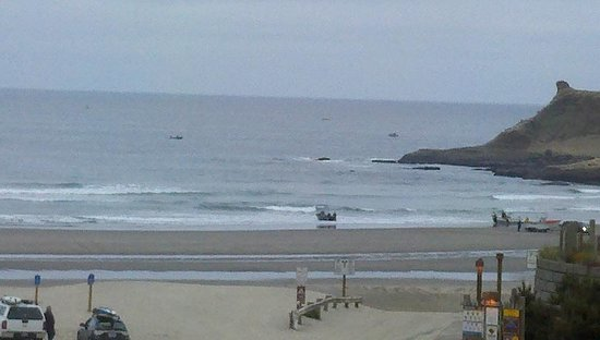 Pacific City, OR: Early morning Dory launch and surfers (May 2013)