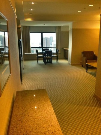 Pacific Regency Hotel Suites: View of living room/dining room area of our 32nd floor suite.