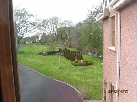 Glin, Ireland: View from window at the front, showing stream and Castle Bridge