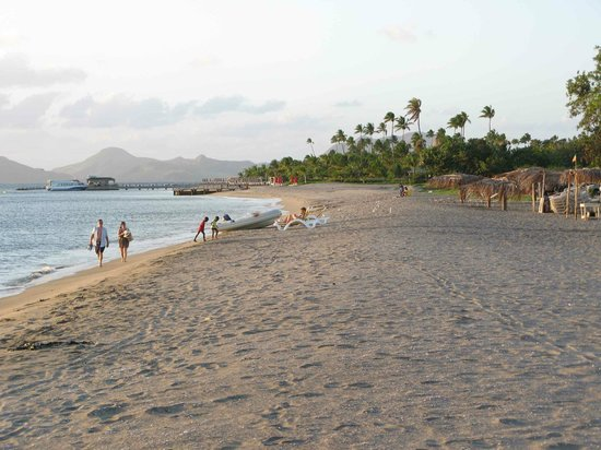 Four Seasons Resort Nevis, West Indies: Pinney&#39;s Beach w hotel grounds in distance
