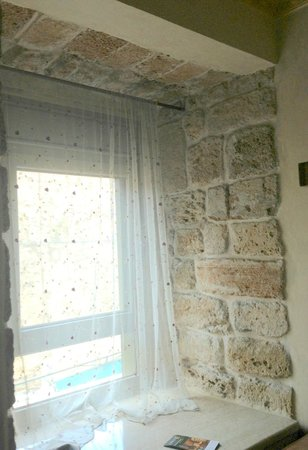 Akkotel: window of the room- this is the old city wall stones