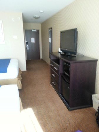 Holiday Inn Express Hotel & Suites Riverport: Nice storage unit with LCD TV. Microwave, fridge & dresser w/ open storage