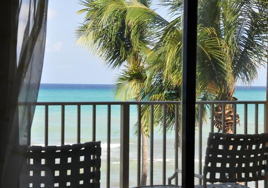 Marriott Grand Cayman Beach Resort: standing in the room looking out toward the ocean, oceanfront room