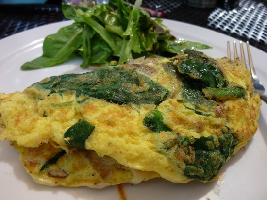 Gilbert, AZ: 3 egg omelet, sauteed bacon, spinach, mushrooms, and swiss cheese served with organic greens