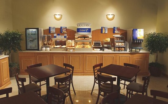 Holiday Inn Express Toronto Downtown : Now serving  bacon, eggs ,sauage, fresh fruit and more.