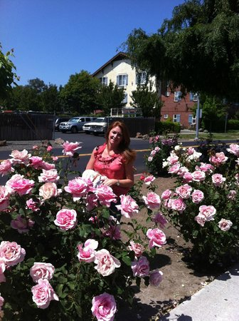 BEST WESTERN PLUS Elm House Inn: My Beautiful wife - pretty in pink.  Flowers were everywhere