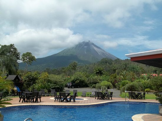 Volcano Lodge &amp; Gardens: view of volcano from pool and restaurant