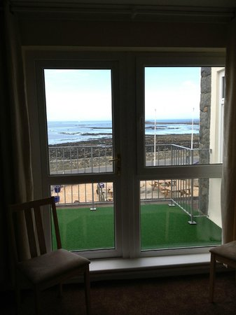 Saint Saviour, UK: Looking from within the room out over the bay