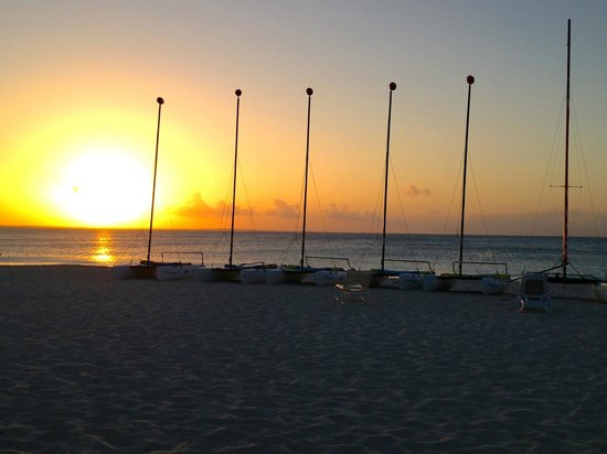 Club Med Turkoise, Turks &amp; Caicos : Sunset  on the beach (Hobby Cat sailboats lined up on the beach) 