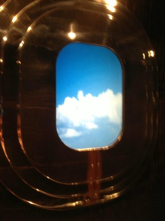 Farnborough, UK : 'Airplane window' in the lifts - the clouds move by...