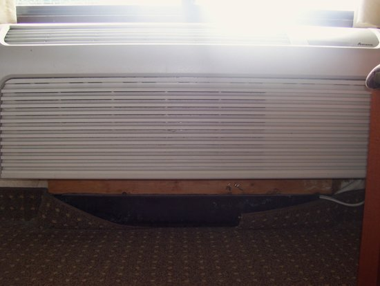 Plymouth, Minnesota: Ripped away carpeting under the heating/cooling unit in our room