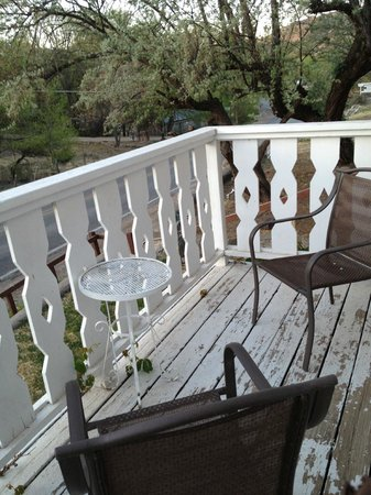 Chimayo, NM: Little balcony outside our room where we'd sit & read