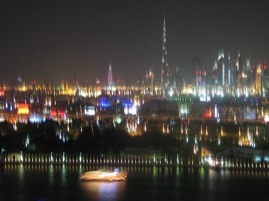 Hilton Dubai Creek: Night view of the creek from the roof bar