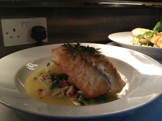 Ivybridge, UK: roasted hake petit pois ala francaise butter sauce