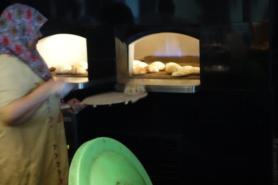 Conrad Cairo: Lady making flat bread in restaurant