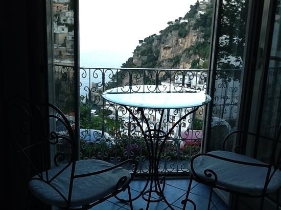 Positano Art Hotel Pasitea: our balcony was too small so we arranged a sitting area in front of our window.