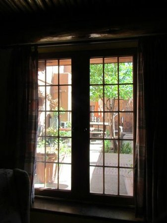 La Dona Luz Inn, An Historic Bed & Breakfast: View of patio from lounge adjacent to master BR