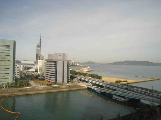 Hilton Fukuoka Sea Hawk: View overlooking the river and ocean with the Fukuoka Tower in the background