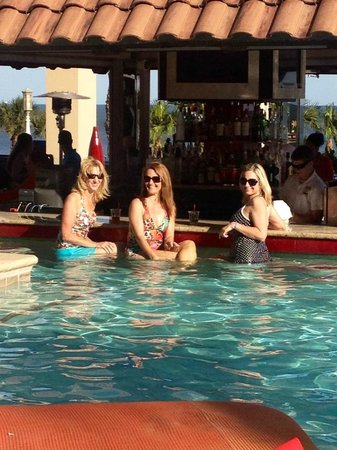 The San Luis Resort: My girls at the swim up bar...so fun!