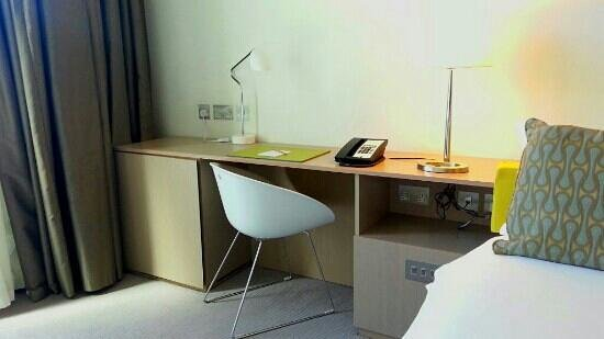 The Gibson Hotel: Desk area with four UK power outlets. More outlets available by television and floating shelf an
