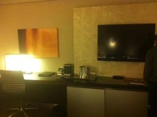 Hilton San Francisco Union Square: desk and tv area. see how dark the room is.