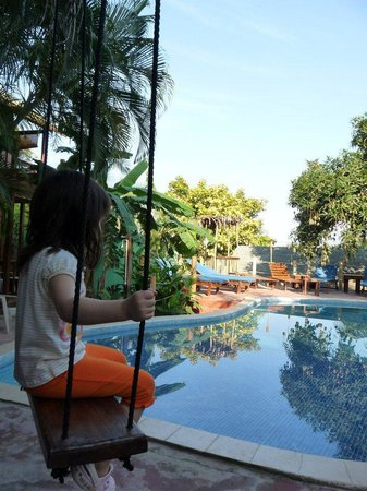 West Bay Lodge: Swing chair by the pool