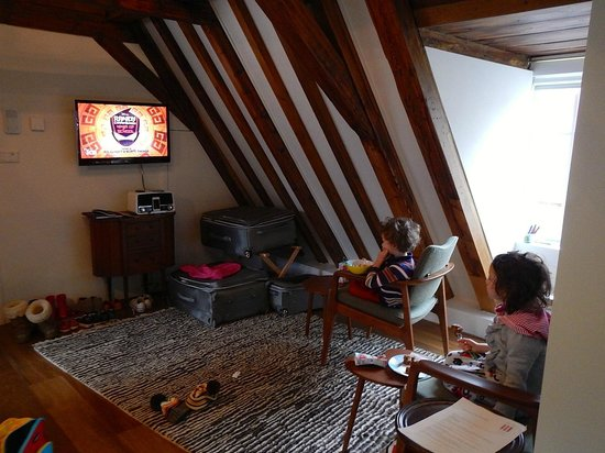 The Weavery Boutique Bed & Breakfast: The kids watching TV in the living area.