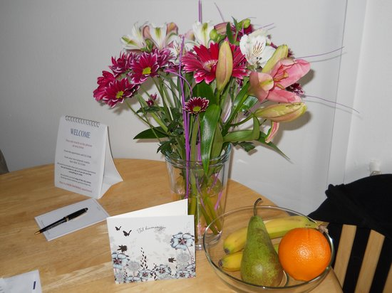 Castle House Luxury Apartments: Fruit, flowers, and anniversary card from our friends at Castle Apartments!