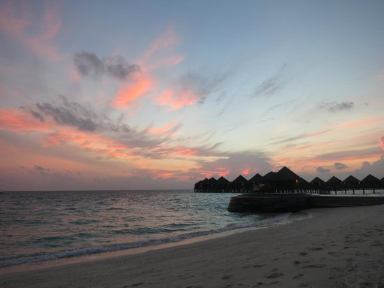Baros Maldives: Sunset view from loungers of Deluxe Villa 119