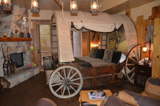 Adobe Grand Villas: The Wagon Wheel room bed! Yee haw!