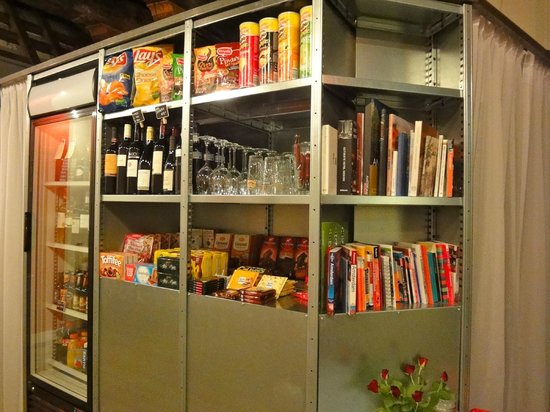 Mauro Mansion : Honestly bar/ snacks and book shelf full of amsterdam travel books