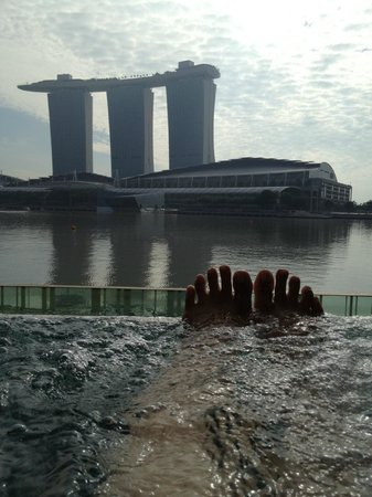The Fullerton Bay Hotel: Luckiest toes in the world! Soaking in the outdoor jacuzzi in our room.