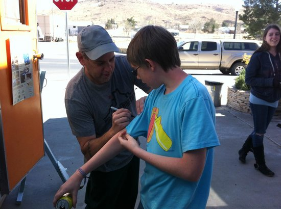Alpine, TX: Signing my son's ironically appropriate T-shirt.