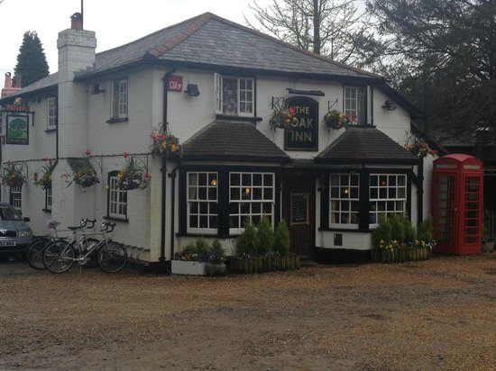 Lyndhurst, UK: A view of the Oak Inn, with our Bikes Outside