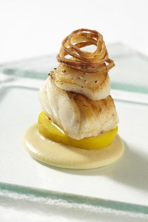 Egham, UK: Cod & scallop, curried potato, onion puree and shallot crisps