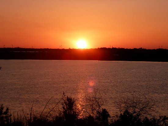 Haines City, FL: SUNSET OVER TOWER LAKE FROM OUR BALCONY AT THE LAKE HOUSE